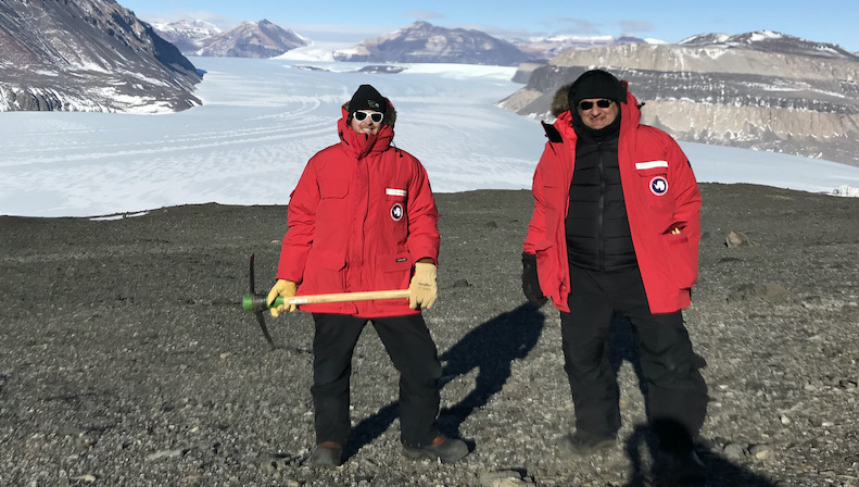 UC Santa Cruz researchers including graduate student Graham Edwards and Professor Slawek Tulaczyk, seen here in front of Taylor Glacier in Antarctica, investigated ice loss from the East Antarctic ice sheet during past interglacial warm periods. (Credit: Terry Blackburn)